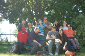 Pegasus Participants and staff are pictured smiling. They are outside in front of trees.