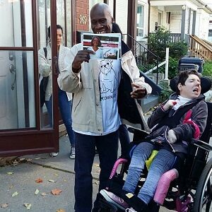 Two participants distributing flyers in the community.