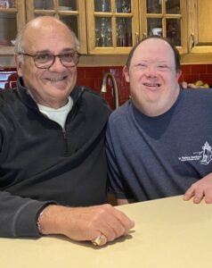 Board member Scott burns with his son. Click to learn more about Scott.